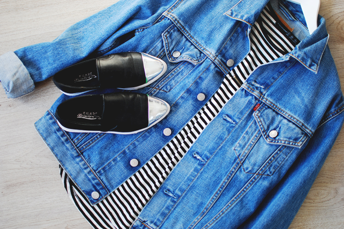 Flatlay shoes and denim jacket