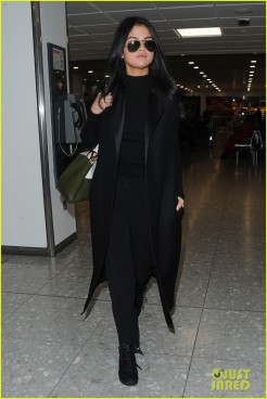 **USA ONLY** London, UK - Selena Gomez and a male companion land at Heathrow Airport on a flight from New York. The pop star is in town for her Friday performance at Children In Need 2015. AKM-GSI November 12, 2015 **USA ONLY** To License These Photos, Please Contact : Steve Ginsburg (310) 505-8447 (323) 423-9397 steve@akmgsi.com sales@akmgsi.com or Maria Buda (917) 242-1505 mbuda@akmgsi.com ginsburgspalyinc@gmail.com